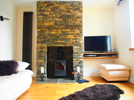 Stonework Fireplace with Free Standing Log Burner